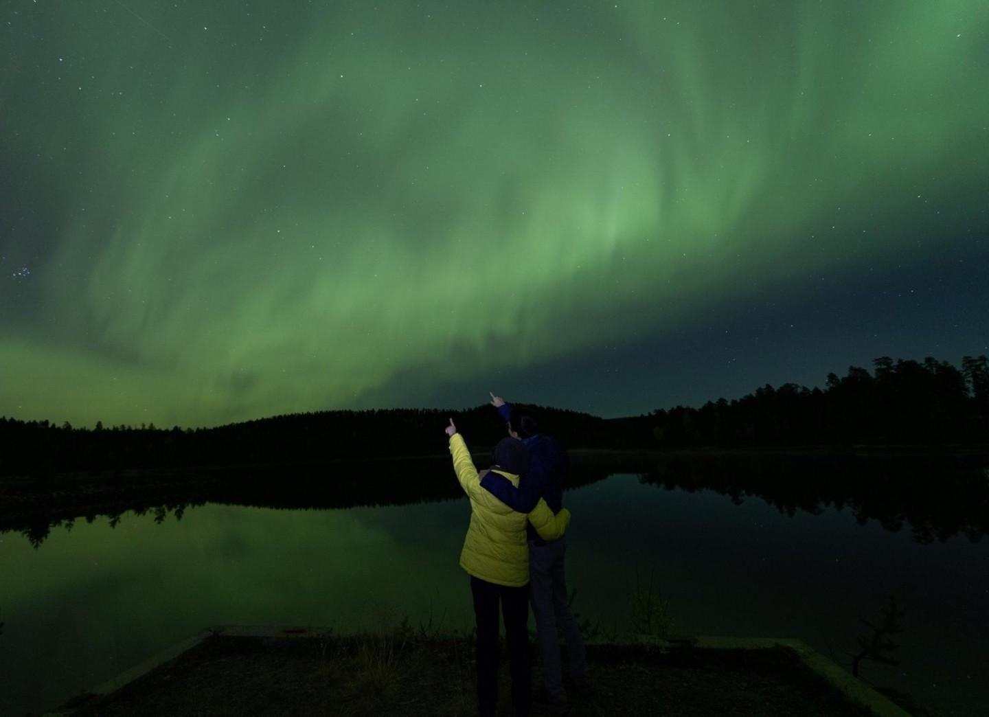 admiring northern lights in Ivalo