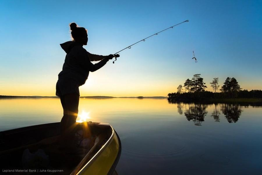 Girl fishing in Lake Inari.