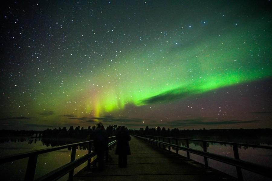 northern lights over the bridge of Paatsjoki