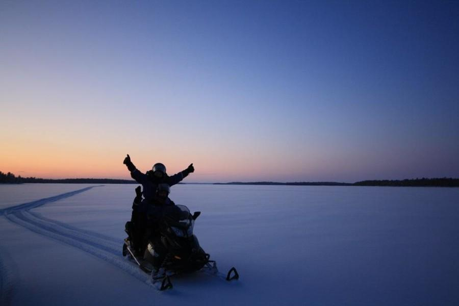 snowmobiling on lake inari